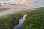 Aerial View of Long Pond on East Branch Tully River as it Flows through Lush Forests and Ground Fog at Sunset, Royalston, MA