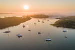 Aerial View of Sun Rising through Fog over Hadley Harbor and Elizabeth Islands, Town of Gosnold, MA
