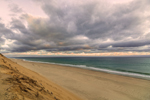 Dark Stormy Clouds at Sunrise over Beach, Cliffs, and Atlantic Ocean at Cahoon Hollow Beach, Cape Cod National Seashore, Cape Cod, Wellfleet, MA