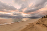 Dark Stormy Clouds at Sunrise over Beach, Cliffs, and Atlantic Ocean at Cahoon Hollow Beach, Cape Cod National Seashore, Cape Cod, Wellfleet, MA