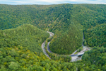 Aerial View of Cold River and Mohawk Trail Scenic Byway Winding through Mohawk State Forest, Berkshire Mountains, Savoy, MA
