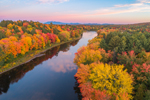 Aerial View of Sunrise over Brilliant Fall Foliage along East Branch Penobscot River with Mount Kathadin in Distance, Katahdin Woods and Waters Scenic Byway, Medway, ME