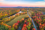 Aerial View of Sunrise over Brilliant Fall Foliage along East Branch Penobscot River and Katahdin Woods and Waters Scenic Byway, Mount Katahdin in Distance, Medway, ME