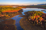Aerial View of Early Morning Light Shining on Compass Pond and Pockwockamus Stream in Fall, off Katahdin Woods and Waters Scenic Byway, Piscataquis County, T2R9 WELS, ME
