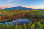 Aerial View of Sunrise over a Small Pond and Mount Katahdin in Fall, off Katahdin Woods and Waters Scenic Byway, Piscataquis County, T2R9 WELS, ME