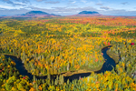 Aerial View of Brilliant Fall Foliage with Big Spencer and Little Spencer Mountains in Distance and Roach River in Foreground, off Moosehead Lake Scenic Byway, View from Lily Bay Township, ME