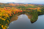 Aerial View of Misery Pond and Brilliant Fall Foliage in Surrounding Forests, Moosehead Lake Region, Misery Township, ME