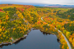 Aerial View of Misery Pond and Country Road through Forests with Brilliant Fall Foliage, Moosehead Lake Region, Misery Township, ME
