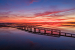 Aerial View of Colorful Sunrise over Marshes and Boardwalk with Reflections at Boardwalk Beach, Cape Cod, Sandwich, MA