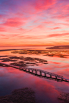 Aerial View of Dramatic Sunrise over Marshes and Boardwalk with Reflections at Boardwalk Beach, Cape Cod, Sandwich, MA