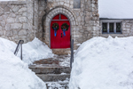 Close Up of Red Doors with Wreaths at Church of Our Saviour in Winter, Killington, VT