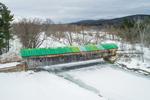 Hammond Covered Bridge in Winter Spanning Otter Creek, Built 1842, Pittsford, VT