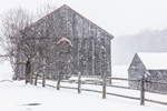 Natural Wood Barn with Wreath and Split-rail Fence during Snowstorm, Marlboro, VT