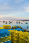 Early Morning Light Shines on Lobster Boats in Barney Cove with Colorful Lobster Pots on Wharf, Beals Island, Town of Beals, ME