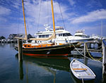 Old Traditional-style Sailboat and Modern Yacht, Boat Basin