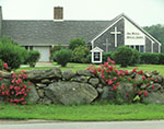 Roses in Bloom on Stone Wall in Front of Old Mystic Baptist Church