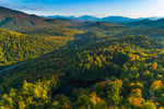 Evening Light Shines over Warren Pond in Early Autumn with Sentinel Range in Distance, Adirondack Park, View from North Elba, NY