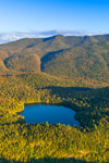 Evening Light Shines over Copperas Pond in Early Autumn with Sentinel Range in Distance, Adirondack Park, View from North Elba, NY