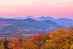 View of Brilliant Fall Foliage from Overlook on Bear Notch Road at Sunset, Presidential Range in Distance, White Mountain National Forest, Bartlett, NH