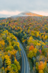 Olympic Trail Scenic Byway Winds through Forests with Fall Foliage in Early Morning, Adirondack Park, Lake Placid, North Elba, NY