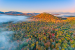 Early Morning Light Shines on Mountains and Forests with Fall Foliage, Adirondack Park, Lake Placid, North Elba, NY