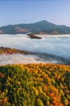 Early Morning Ground Fog Hovers over Mountains and Forests in Autumn, Whiteface Mountain in Distance, Adirondack Park, Lake Placid, North Elba, NY