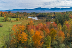 Pond and Wetlands in Autumn with Franconia Range in Distance, White Mountains Region, View from Sugar Hill, NH
