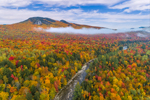 Morning Ground Fog Hovers over Brilliant Fall Foliage near Pine Mountain and Peabody River, White Mountain National Forest, Gorham, NH