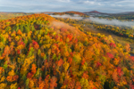 Early Morning Light Shines through Ground Fog over Fall Foliage in Forests and Hills near Clyde River, Northeast Kingdom Region, Village of East Charleston, Charleston, VT