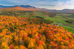 Brilliant Fall Foliage on Hillside with Rural Farmland and Mount Mansfield in Distance, Green Mountains Region, Cambridge, VT