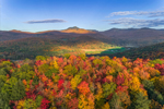 Early Evening Light Shines on Brilliant Fall Foliage in Green Mountains with Camels Hump in Distance, View from Huntington, VT