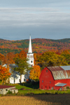 Early Evening Light Shines on Cornfield, Red Barn, and The Congregational Church of Peacham in Autumn, Northeast Kingdom, Peacham, VT
