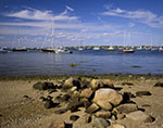 Rocks on Shoreline of Great Salt Pond with Boats at Moorings, New Harbor