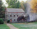 Longfellow's Wayside Inn Grist Mill in Fall with Mist over Waterfall