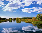 Cumulus Clouds and Blue Sky with Reflections in Sudbury River in Fall, Great Meadows National Wildlife Refuge