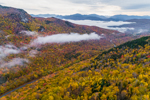 Early Morning Fog Lifting over Colorful Fall Foliage in White Mountain National Forest, View from Mount Waternomee, White Mountains Region, Woodstock, NH