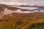 Early Morning Fog Lifting over Country Road and Colorful Fall Foliage in White Mountain National Forest, View from Mount Waternomee, White Mountains Region, Woodstock, NH