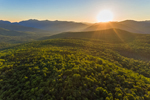 Sun Rises above Mountaintops in White Mountain National Forest, Woodstock, NH
