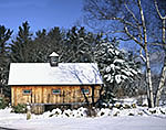 Natural Wood Barn after Snowfall