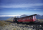 Cog Railway at Summit of Mt. Washington with Presidential Range in Background,