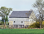 Light Gray Barn with Stonework in Spring