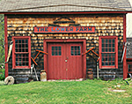 Old Cedar-shingled Barn with Red Trim at The Inn at Lower Farm Bed and Breakfast