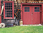 Close-up of Cedar-shingled Barn with Red Trim and Old Farm Tools, The Inn at Lower Farm Bed and Breakfast