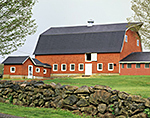 Big Red Barn in Spring with Stonewall in Foreground
