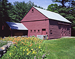Red Barn with Flowers on Clear Summer Day