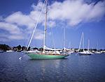 "Sailing Yawl ""Yumi"" under Blue Skies in Stirling Harbor, Long Island, Village of Greenport"