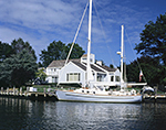 Sailing Ketch and Waterfront Home under Blue Skies, Gull Pond, Long Island