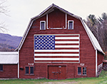 Old Red Barn with September 11 US Flag Tribute in Early Winter