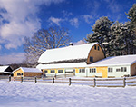 Cedar-shingled Barn after Fresh Snow under Blue Sky with White Puffy Clouds