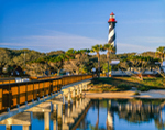 Early Morning Light at St. Augustine Lighthouse and Pier with Reflections in Salt Run, Anastasia Island, St. Augustine, FL